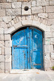 Wooden blue door in Madaba. Jordan Royalty Free Stock Image