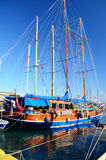 Wooden blue fishing ship in a sea port royalty free stock photo
