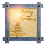 Wooden blue frame with nails in shape of sun against a white bac Stock Photos
