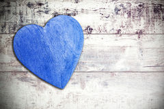 Wooden blue heart on timbered background, space for text Royalty Free Stock Photo