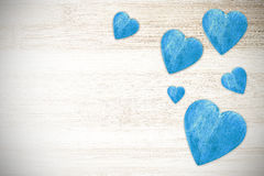 Wooden blue hearts on timbered background, space for text. Royalty Free Stock Photos