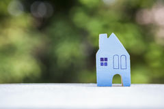 Wooden blue house over blurred nature bokeh background Royalty Free Stock Photos