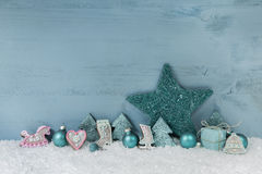 Wooden blue or mint green christmas background with decoration. Royalty Free Stock Images
