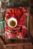 Wooden board of Assorted Cured Meats Royalty Free Stock Images