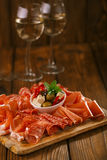 Wooden board of Assorted Cured Meats Royalty Free Stock Photo