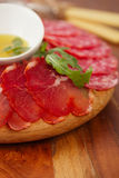 Wooden board of Assorted Cured Meats Royalty Free Stock Photos