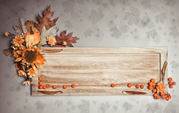 Wooden board with Autumn decorations Royalty Free Stock Photos
