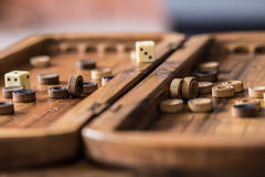 Wooden Board with backgammon, pawns, dice, close up Stock Image