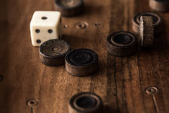 Wooden Board with backgammon, pawns, dice, close up Stock Photography
