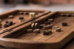 Wooden Board with backgammon, pawns, dice, close up Royalty Free Stock Photos