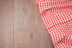 Wooden board background with red checked tablecloth. View from above Stock Photography