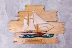 A wooden board with a ship stock photography