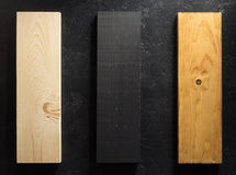 Wooden board at black background Stock Photography