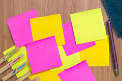 Wooden board with blank sticky notes. Stock Photography