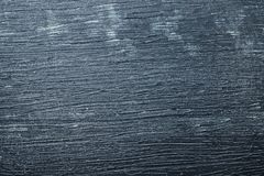 Wooden board with blue color. Paint and scratches Stock Photography