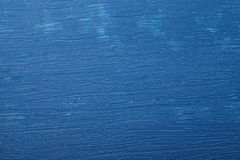 Wooden board with blue color. Paint and scratches Stock Image