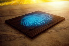 Wooden board with blue fingerprint Stock Photo