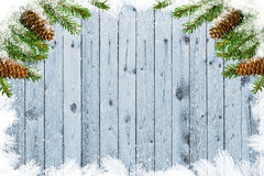 Wooden board with branches of fir Royalty Free Stock Images