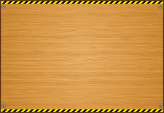 Wooden Board With Caution Tape Stock Photo