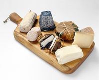 Wooden board with cheese assortment Royalty Free Stock Images