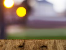Wooden board on a colorful blurry background. Bokeh abstract tabletop summer plank spring product montage design surface empty deck display green nature blurred royalty free stock photos