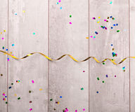 Wooden board with colorful streamers Stock Image