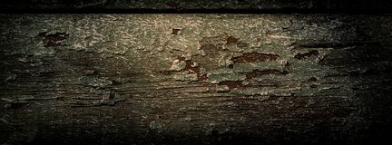 Wooden board is covered with old paint and traces of whitewash. royalty free stock photography