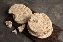 Wooden board with crunchy rice cakes. On table stock photos