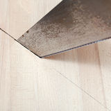 Wooden board is cut with hacksaw Royalty Free Stock Photography
