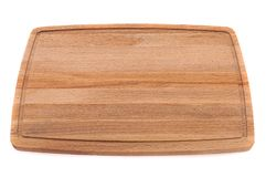 Wooden board for cutting meat with blood flow on a white background. royalty free stock photography