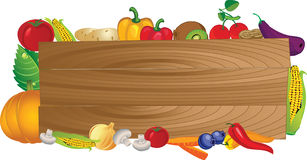 Wooden board with different fruits and vegetables Royalty Free Stock Photo