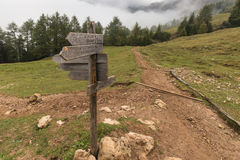 Wooden board with directions in Dolomites Royalty Free Stock Photography