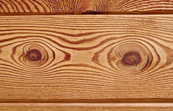 Wooden board with distinctive grain and two gnarls Royalty Free Stock Photography