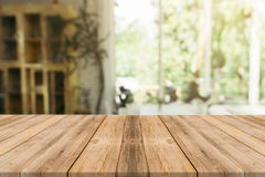 Wooden board empty table in front of blurred background. Perspec stock photography