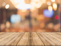 Wooden board empty table in front of blurred background. Perspec. Tive brown wood over blur in restaurant - can be used for display or montage your products.Mock Royalty Free Stock Image