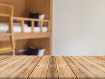 Wooden board empty table in front of blurred hotel building background. Perspective brown wood over blur bedroom. Royalty Free Stock Image