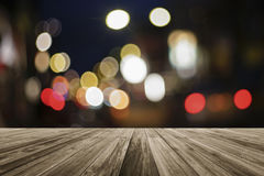 Wooden board empty table in front of colorful blurred backgroundWooden board empty table in front of colorful blurred background Royalty Free Stock Images