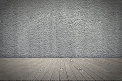 Wooden board empty table in front of rough wall Stock Image