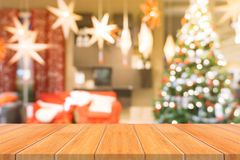 Wooden board empty table top on of blurred background. Perspective brown wood table over blur christmas tree background. stock photos