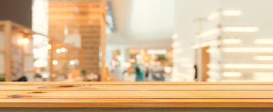 Wooden board empty table top blurred background. Perspective brown wood table over blur in coffee shop background.Panoramic banner royalty free stock image