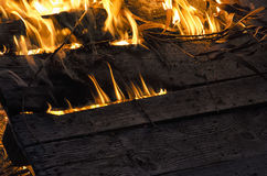 Wooden board engulfed in flames. View of wooden board engulfed in flames Royalty Free Stock Images