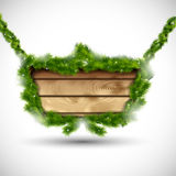 Wooden board with fir branches Stock Photo