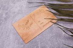 Wooden board in the form of a postcard royalty free stock photo