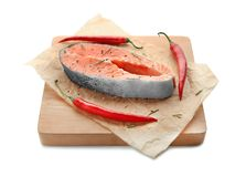 Wooden board with fresh salmon steak on background. Wooden board with fresh salmon steak on white background Royalty Free Stock Photography