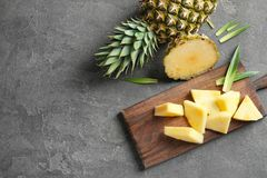 Wooden board with fresh sliced pineapple. On table Royalty Free Stock Photography
