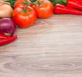 Wooden board with  fresh vegetables. Blank wooden board   with frame of  fresh colorful vegetables Stock Photography