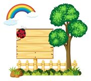 Wooden board in garden with tree and rainbow. Illustration Royalty Free Stock Photo