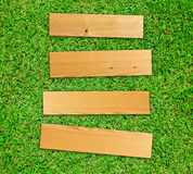 Wooden board on grass Royalty Free Stock Images