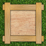 Wooden board on grass Royalty Free Stock Photo