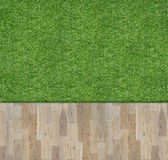 Wooden board on green grass Royalty Free Stock Photos